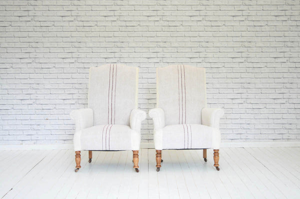 A pair of high-backed Victorian armchairs on prettily turned beech legs  in Hungarian sack cloth