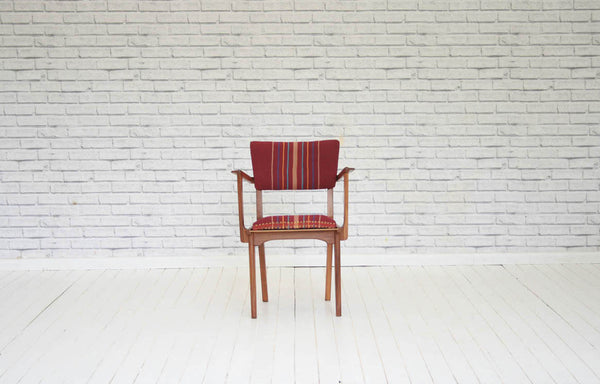 A 1950's/60's designer elbow chair / armchair / desk chair upholstered in vintage West African Nupe cloth
