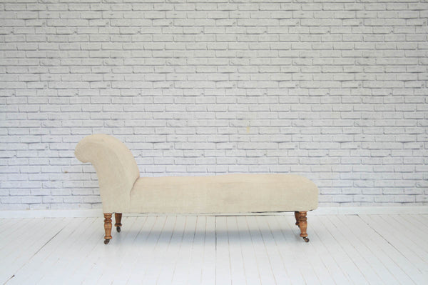 A Victorian chaise lounge with turned beech legs & upholstered in vintage Hungarian sack cloth