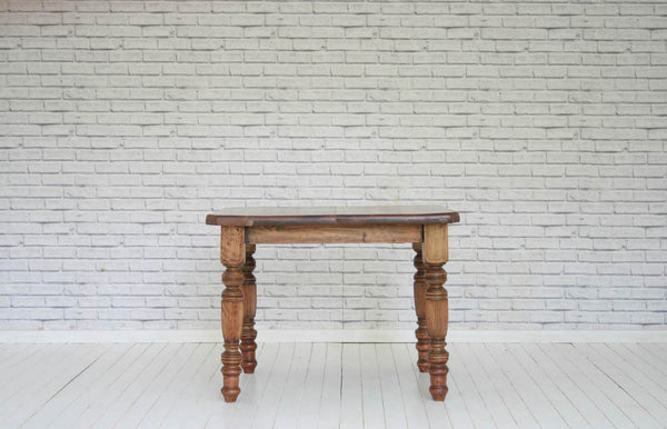 A four seater Victorian pine kitchen table