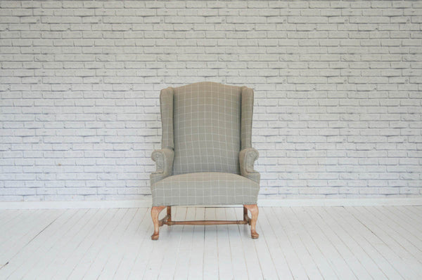 An Edwardian wingback armchair upholsterted in Foy & Co Chalk Check linen