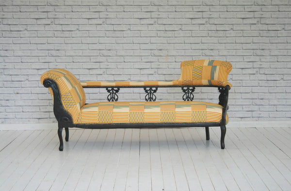 A Victorian double ended chaise lounge upholstered in Rwandan Kitenge wax cloth