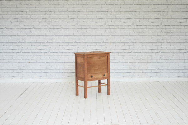A mid 20th century Oak  sewing box / side table