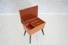A vintage retro mahogany sewing box on tapered black legs/Side table