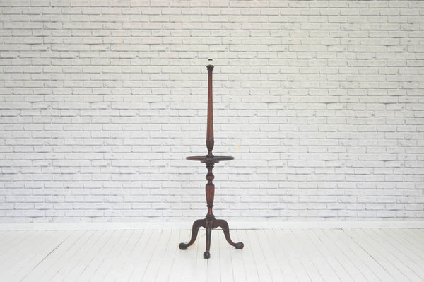 A vintage mahogany side table / floor lamp without shade