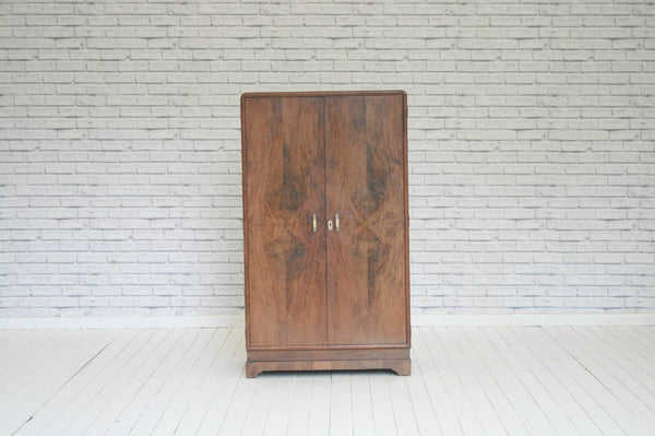 An Art Deco walnut compact wardrobe with fitted interior