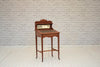 An Edwardian mahogany writing desk with leather inset top