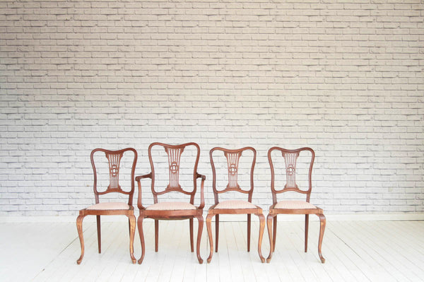 A set of four Edwardian mahogany dining chairs