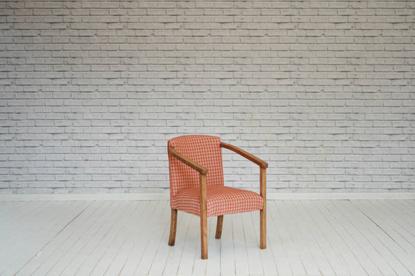 A 1930s elbow chair in heavy woven checked cotton/Armchair