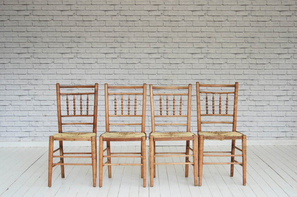 A charming set of four elm kitchen chairs with woven seats