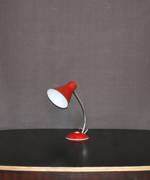 A vintage red gooseneck table lamp