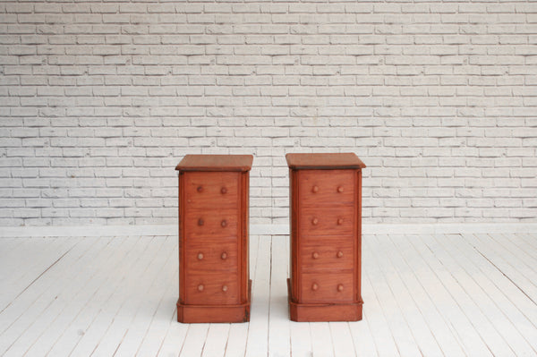 A pair of Victorian mahogany and oak bedside cabinets with faux four drawer fronts