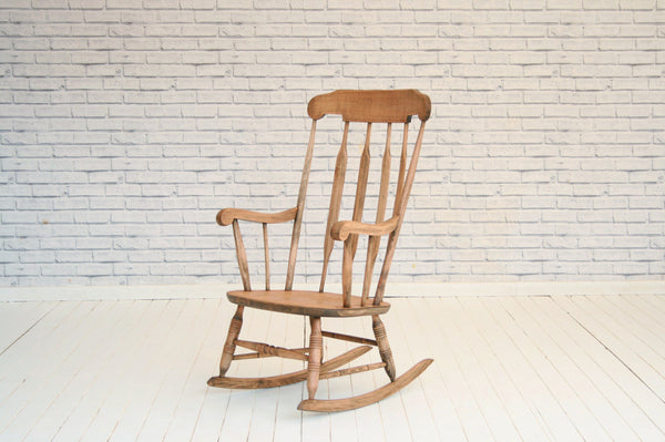 A vintage pine rocking chair / armchair
