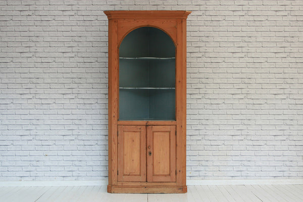 A Victorian English pine corner cupboard with painted interior