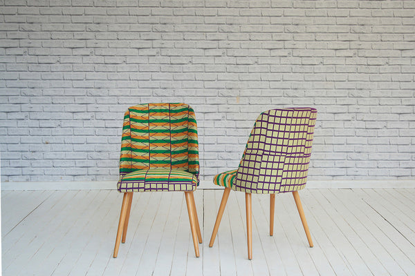 A pair of 1940's/50's vintage dining chairs in contemporary Ghanian Kente cloth