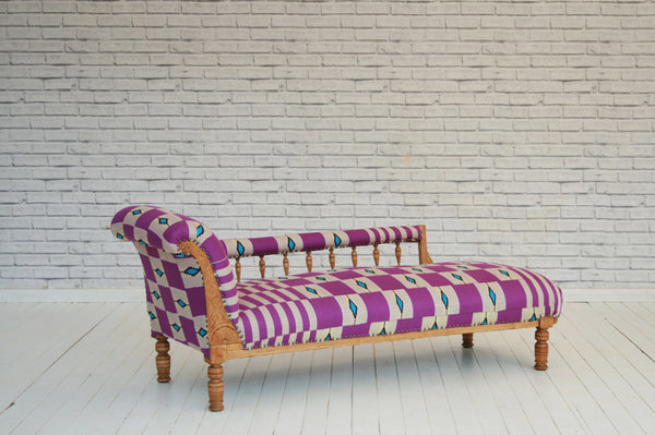 An Oak framed Victorian chaise lounge in fuschia modern Ghanaian Kente cloth