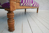 An Oak framed Victorain chaise lounge in fuschia modern Ghanaian Kente cloth