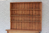 A large Victorian pine kitchen shelving unit