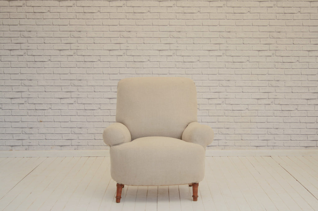 An overstuffed Victorian armchair in Foy & Co pale grey linen