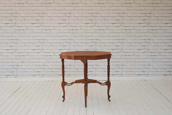 An Edwardian Mahogany side table with prettily scalloped edge