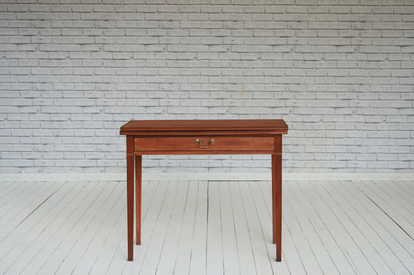 A Victorian mahogany folding card table with single drawer/side table