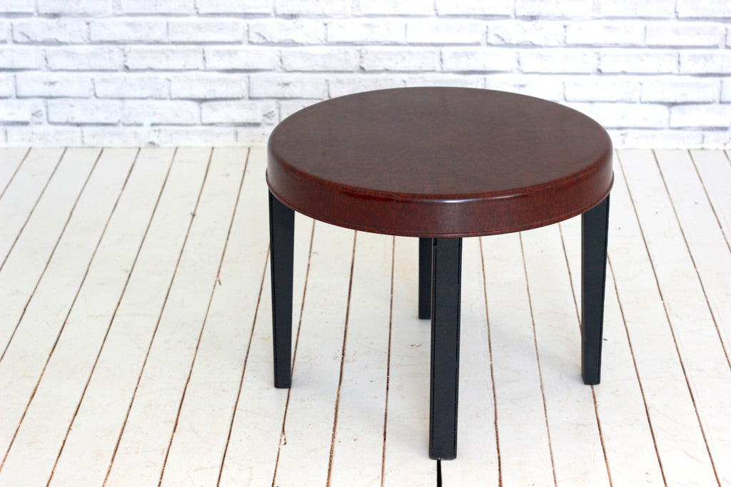 A 1960s molded melamine & wood side table