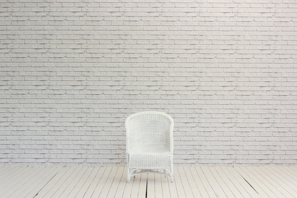 A white painted wicker garden chair