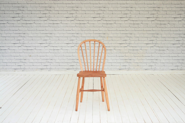 A single hoop backed kitchen chair