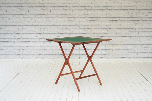 An Edwardian mahogany games table/Occasional table