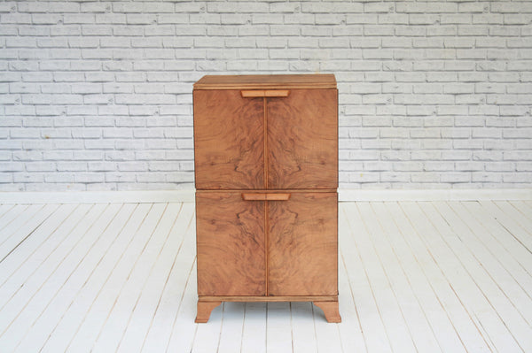 A 1960s walnut four door record cabinet