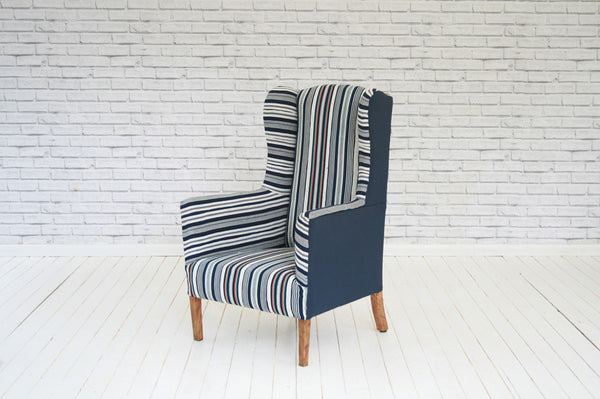 An Edwardian armchair upholstered in vintage Ivorian Guro cloth