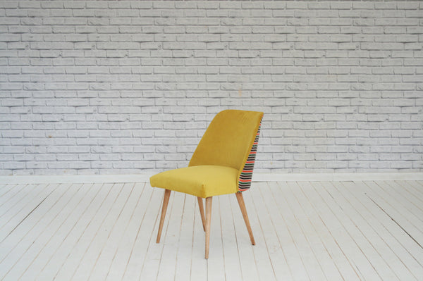 A 1950s  desk or dining chair in yellow velvet with Turkish silk back panel