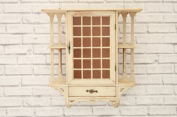 An Arts & Crafts painted wall cabinet