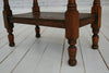 A vintage Oak two tier occasional table
