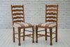 A set of five oak ladder back dining chairs