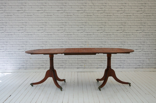 An early 20th century mahogany D-end extending dining table