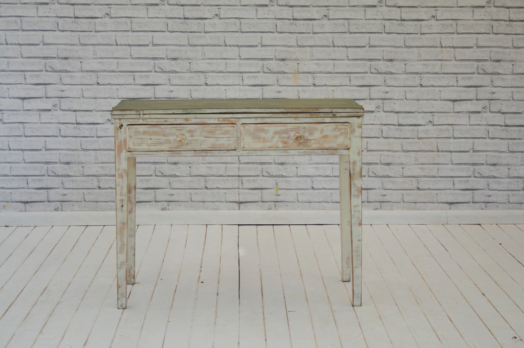 A paint distressed two drawer side table with fold over top
