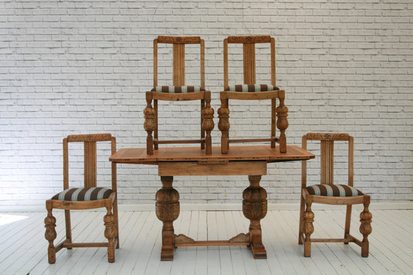 An English oak extending dining table & four chairs
