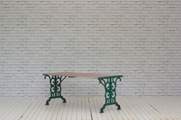 A slat top garden table with cast iron base.