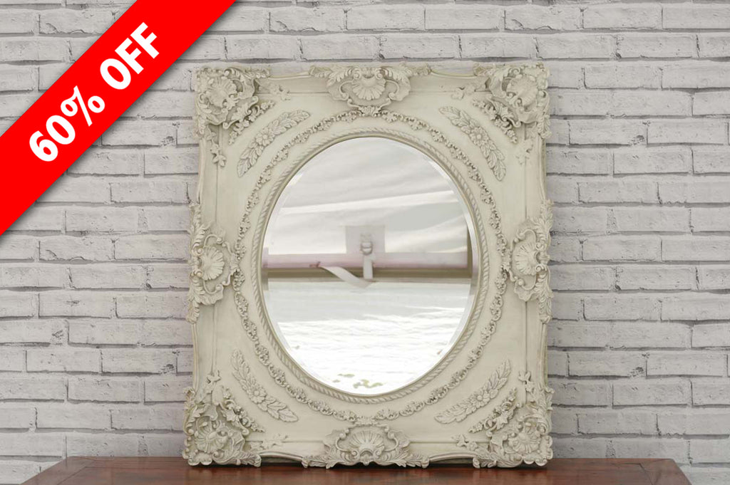 A large ornately carved vintage wall mirror