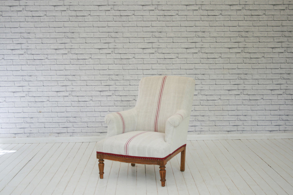 An 1800s French armchair in Hungarian sack cloth