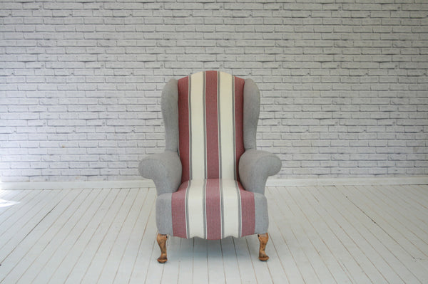 A vintage wingback armchair in stunning Foy & Co heavy duty wool