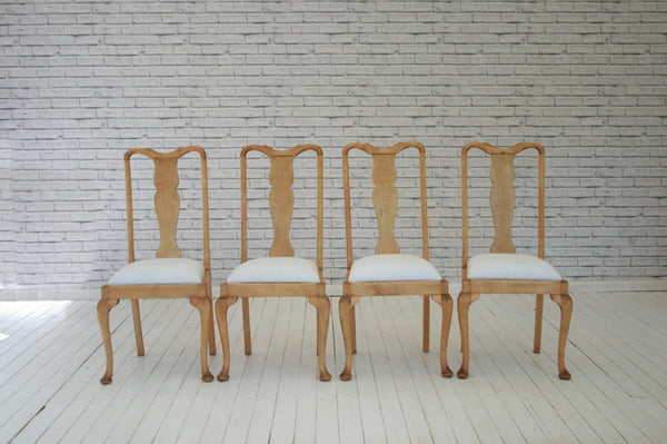 A set of four pine Queen Anne Style dining chairs