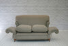 A charming early 20th century drop arm cottage sofa
