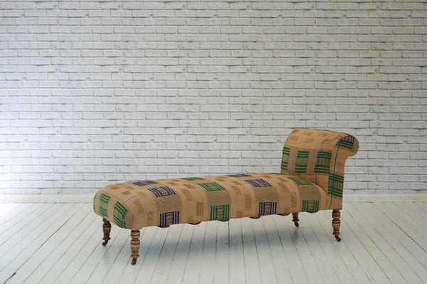 An Edwardian chaise lounge in vintage West African Asoke