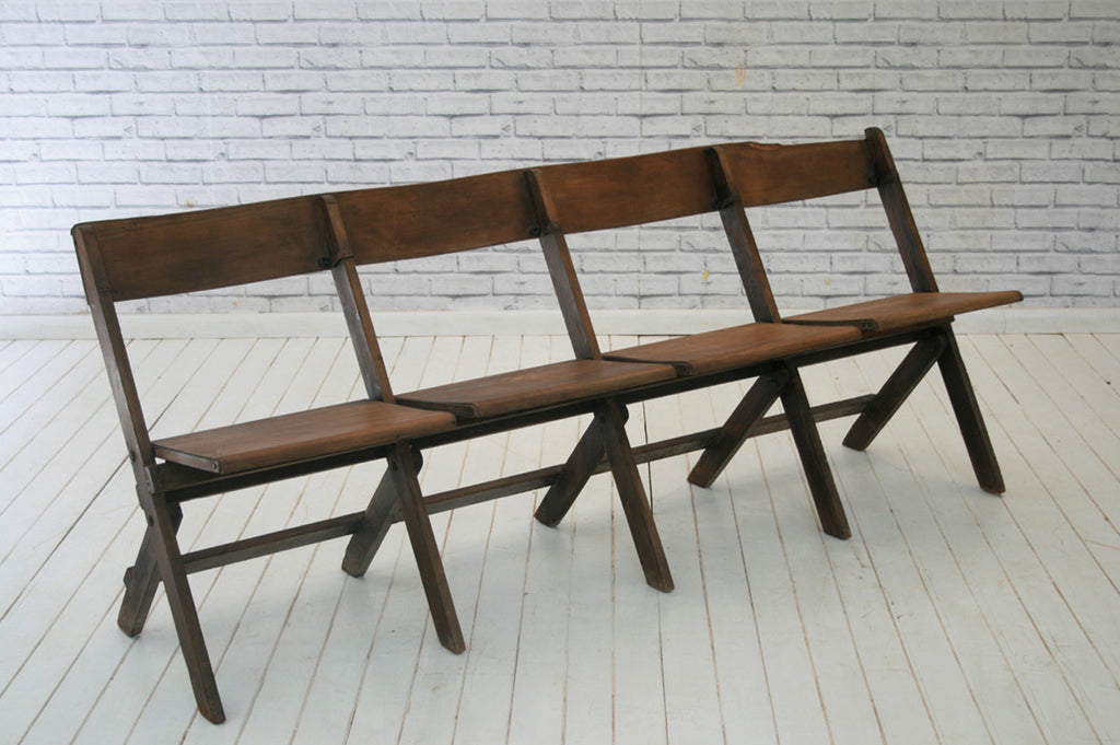 A four seater wooden cinema bench