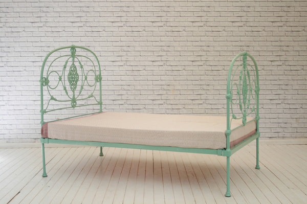 A Victorian painted iron single bed frame