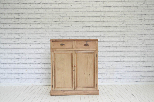 A Victorian pine two drawer over two door cupboard