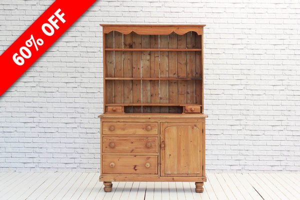A Victorian English Pine dresser with cupboards below