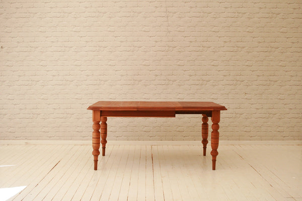 A Victorian mahogany wind-out dining table with extra leaf